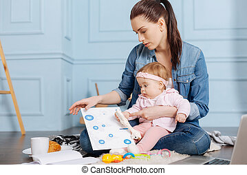 Creative ambitious mother developing some ideas