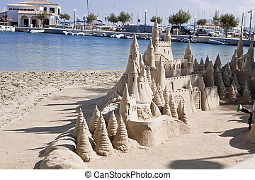 creative big sandcastle on the beauch in summer