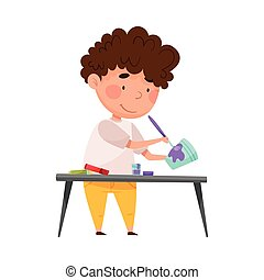Creative Boy Crafting at Desk Painting Used Paper Cup Vector Illustration. Inventive Kid Engaged in Upcycling Reusing Recyclable Material Concept