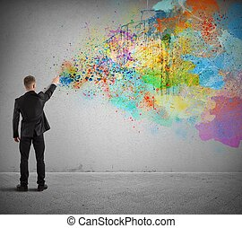 Concept of creative business with businessman and spray paint colors