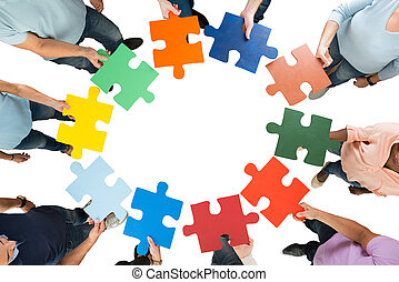 Creative Business Team Holding Colorful Jigsaw Pieces