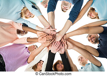 Creative Business Team Stacking Hands In Huddle - Directly...