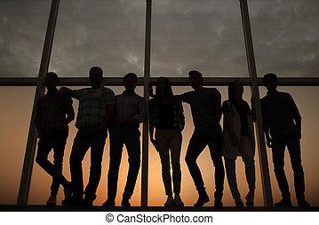 creative business team standing near the office window.