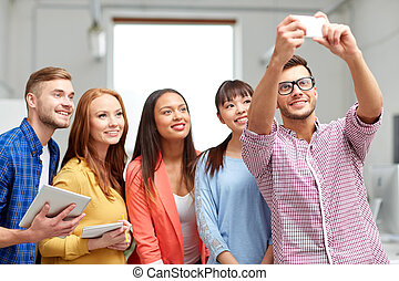 creative business team taking selfie at office