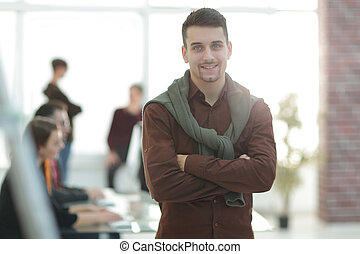 creative businessman on background of office