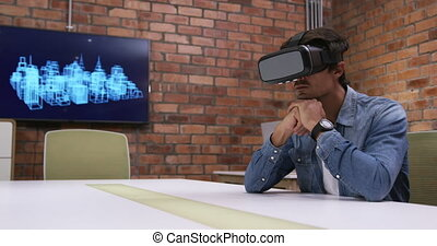Creative businessman using virtual reality headset in modern...