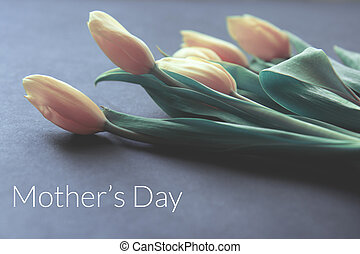 Creative card for Happy Mother's Day with yellow tulips on a delicate background