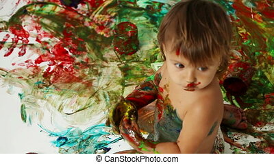 Creative chaos - The above-view of a creative kid making a...