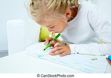 Creative child - Close-up of a creative girl drawing with a...