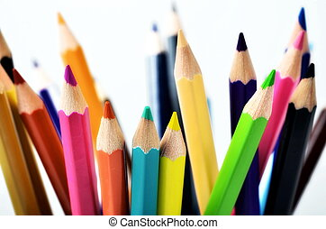Colorful Pencil isolated on white arranged into a creative background and/or creative object