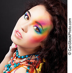 Creative colorful makeup - fashion beauty woman painted face...