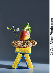Creative composition of food, sponges, wood and flowers. Advertisement idea. Minimal nature concept. Clean and health concept.