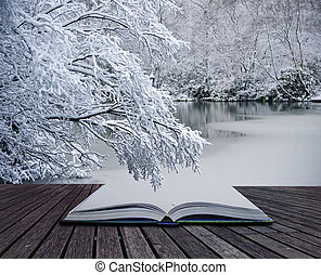 Creative concept idea of Winter landscape coming out of...