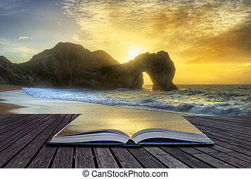 Creative concept image of sunrise over ocean with rock stack...
