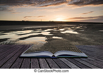 Creative concept pages of book Beautiful sunrise reflected in low tide water pools on beach landscape
