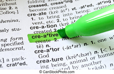 The word creative highlighted in a dictionary.