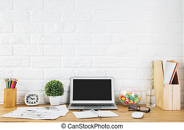Creative designer workspace with blank laptop