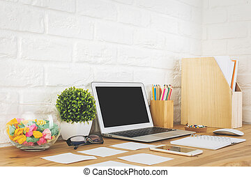 Creative designer workspace with empty laptop