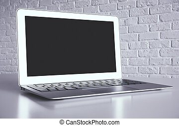 Creative desktop with empty laptop