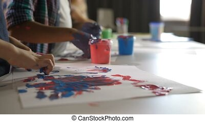 Creative diverse children finger drawing at lesson - Closeup...