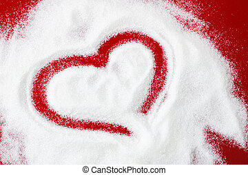 Creative drawing of a heart on sugar, on a red background. The concept of Valentine's Day, sweets. Copy space