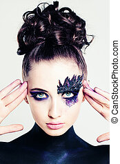 Creative Fashion Look. Young Woman with Makeup