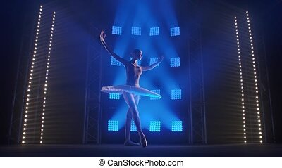 Creative female choreographer setting a ballet performance, dancing and doing various moves in the rays of blue light - arts concept 4k Slow motion footage