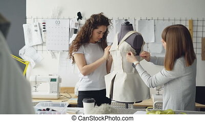 Creative female clothing designers are pinning cut out...