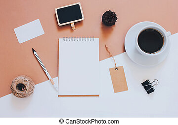 Creative flat lay photo of workspace desk with smartphone, coffee, tag and notebook with copy space background