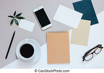 Creative flat lay photo of workspace desk with smartphone, coffee, tag, letter and notebook with copy space background
