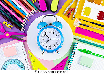 Creative flat lay top view back to school concept with alarm clock.