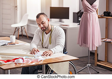 Creative focused tailor searching for matching colors -...