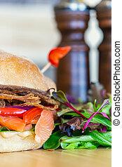Creative food photography of salmon sandwich