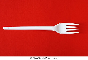 creative fork - creative of single plastic fork on red...
