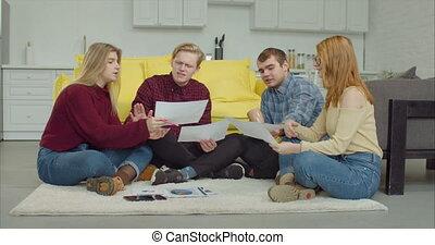 Creative freelance team brainstorming in home office