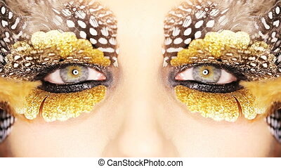 Creative Golden Eye Makeup - Closeup of a womans eyes with...