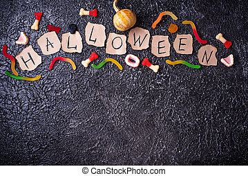 Creative Halloween background with  treats