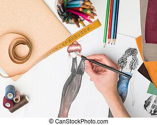 creative hand - female hand drawing fashion sketch on desk...