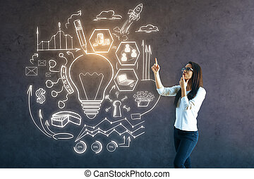 Creative idea concept - Attractive girl pointing at business...