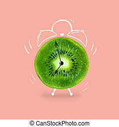 Creative idea layout fresh kiwi slice alarm clock on pastel pink background