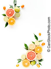 Creative layout made of summer tropical fruits: grapefruit, orange, lemon, lime and leaves ficus. Food concept. flat lay, top view