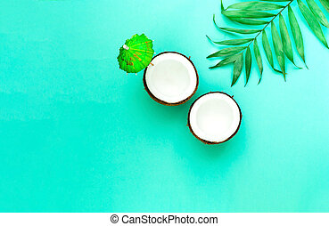 Creative layout of coconuts mit decorative umbrella on green background. Trendy color 2020. Copy space
