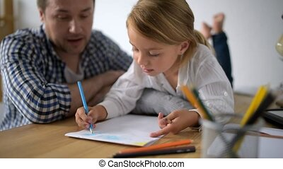 Creative little girl drawing with her father at home