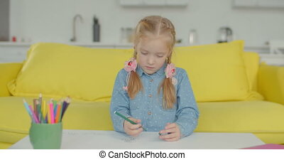 Creative little girl engrossed in drawing at home - Creative...