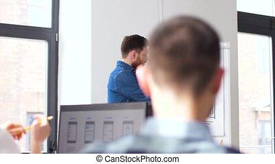 creative man at user interface presentation - business,...