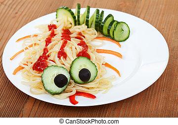 Creative pasta dish on wooden table