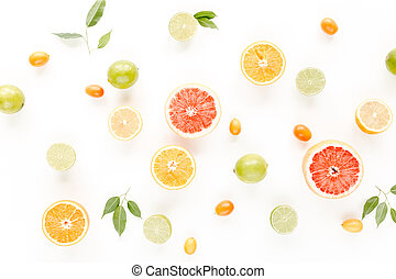 Creative pattern made of summer tropical fruits: grapefruit, orange, lemon, lime and leaves ficus. Food concept. flat lay, top view