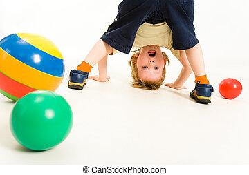 Creative - Portrait of boy looking at camera between his...