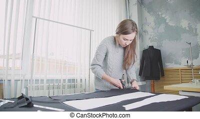 Creative profession. Woman creates designer clothes. Seamstress