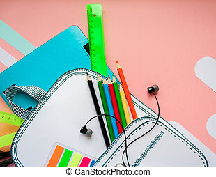 Creative school bag made of paper with school stationery....